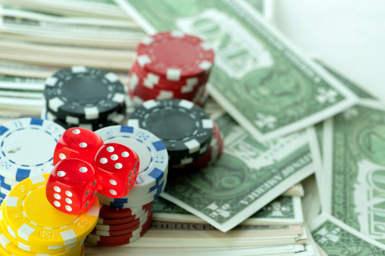 Gambling Finance Opportunity Luck Currency Arts Culture And Entertainment Gambling Chip Indoors  Leisure Games Red Wealth Stack Casino No People Poker - Card Game Dice Leisure Activity Relaxation Close-up Paper Currency Luxury