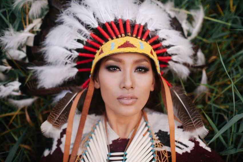 The Portraitist - 2017 EyeEm Awards Headshot Headdress One Person Only Women Young Adult One Woman Only Adults Only One Young Woman Only Adult Front View Portrait Close-up Feather  People Laurel Wreath Day Crown Outdoors Beautiful Woman Flower Native American Indian The Week On EyeEm The Week On EyeEm Press For Progress
