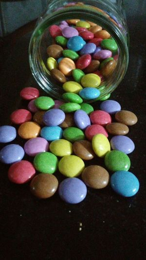 Multi Colored Candy Variation Large Group Of Objects Indoors  No People Close-up Capsule Rubber Band Day Sweet Food Temptation Glass Bottle Gems In Bottle Gems Ready-to-eat Chocolate Colourful Eating Eating Gems Colourful Marbles Eating Marbles Eating Circle Easter Choice