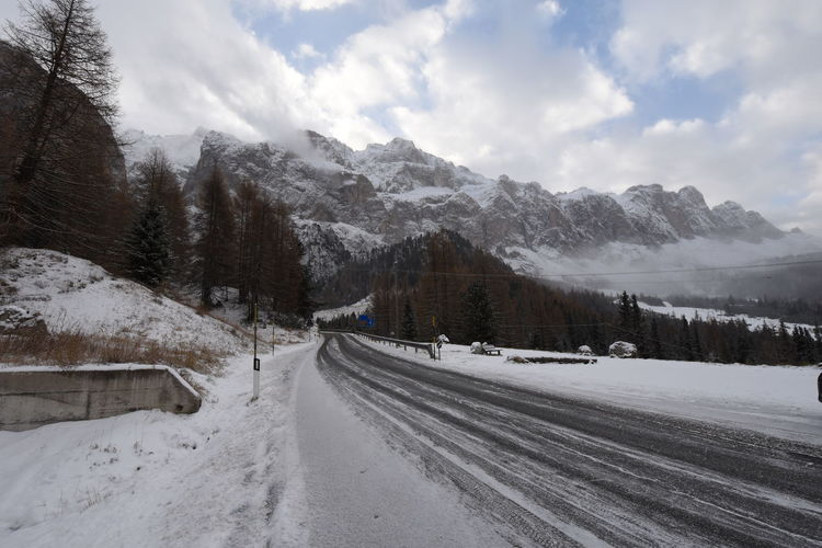first snow on dolomites southtyrol italy Passo gardena Church Clouds And Sky Cold Temperature Day Dolomites, Italy EyeEm Nature Lover Fence Flowers Italy Mountains Mountains And Sky Nature No People Outdoors Sky Snow Snowcapped Mountain Southtyrol  Streetphotography Travel UNESCO World Heritage Site Val Gardena Valley Way Winter