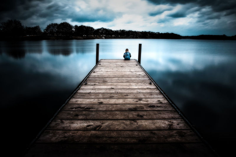 Alone Kids Of EyeEm Alone Children Children Of The World Kids Light Sitting Beauty In Nature Child Childhood Children Photography Cloud - Sky First Eyeem Photo Girl Kidsphotography Lake Mood Nature Pier Plank Sky Tranquil Scene Tranquility Water EyeEmNewHere The Great Outdoors - 2018 EyeEm Awards The Portraitist - 2018 EyeEm Awards