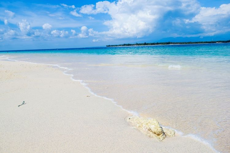 Beach Sea Sand Horizon Over Water Cloud - Sky Sky Vacations Nature Water Scenics Tropical Climate Blue Travel Destinations Beauty In Nature Idyllic Tranquil Scene Tranquility Sun Sunny Outdoors