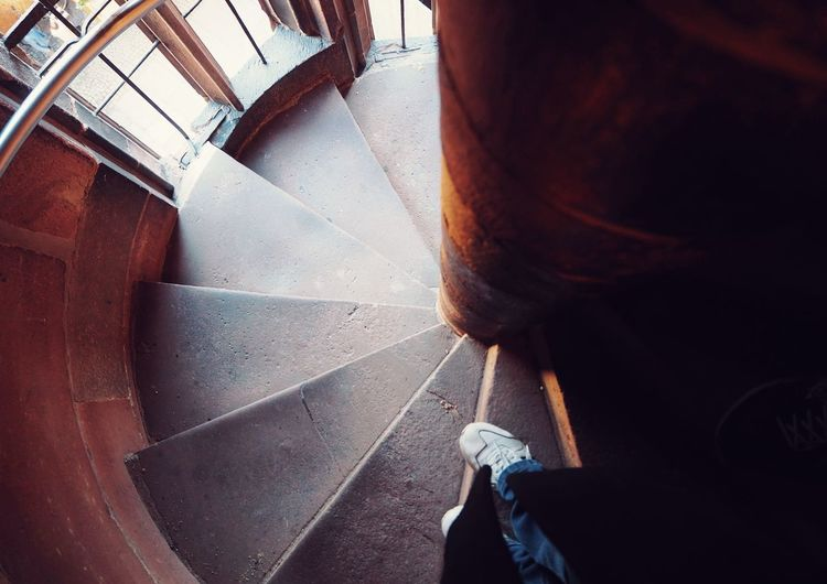 Low section of person standing on staircase