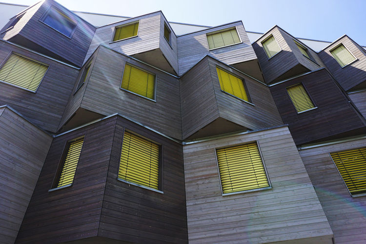 modern architecture in Berlin Marzahn Built Structure Architecture Building Exterior Building Low Angle View No People Sky Window Day Pattern Outdoors City Glass - Material House Residential District Clear Sky Side By Side In A Row Repetition Modern Architecture Wooden Material Berlin
