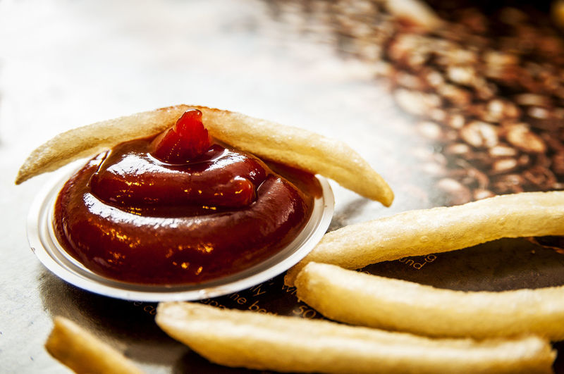 Close-up of french fries with sauce on table
