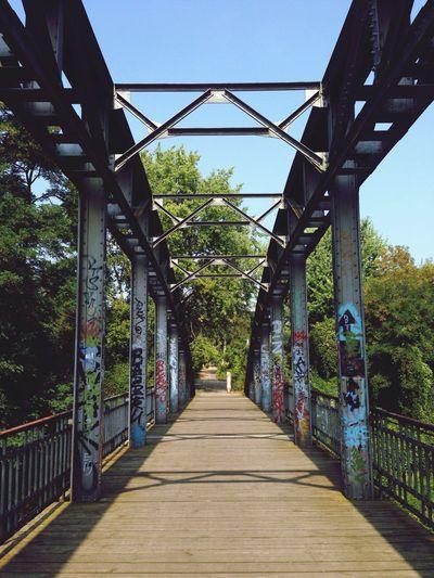 Bridge leading to bridge against sky