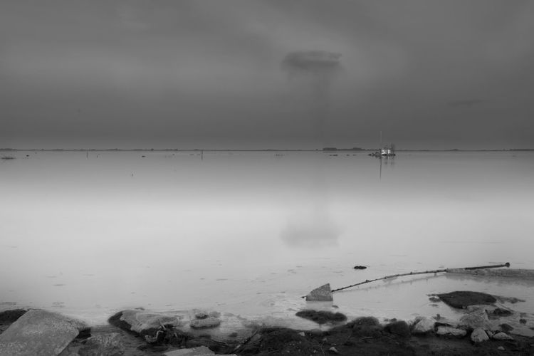 Blackandwhite Black And White Black & White Long Exposure Longexposure Water Scenics - Nature Tranquil Scene Sky Tranquility Beauty In Nature Cold Temperature Nature No People Sea Winter Non-urban Scene Cloud - Sky Day Fog Land Outdoors Reflection Pollution