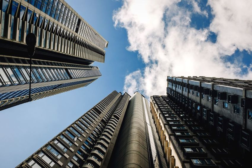 Gray blue Downtown District Office Building Apartment Buildings Residential District Residential Structure Bladerunner Hong Kong Architecture Building Exterior Built Structure Modern Low Angle View Sky City Skyscraper Outdoors No People Tokyo Tourist Destination Modern Architecture Skyline Urban Landscape The Week On EyeEm City Gray