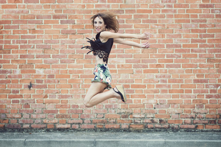 Athletic City Fly Free Freedom Fun Holidays Jump Jumping ! Lifestyle Wall Active Beautiful Woman Beauty Brick Wall Enjoy Feel Girl Health Jumping One Woman Only Only Women Street Urban