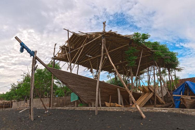 INDONESIA Sumbawa Wooden Boat Beach Black Sand Boat Building Boat Yard Craftmanship Hand Made Island Ship Yard Traditional Wood - Material Wooden