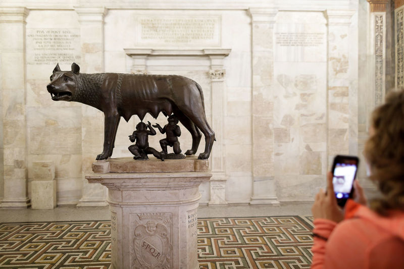 The statue of the she-wolf, symbol of Rome, in a room of the Capitoline Museums, while being photographed by a tourist. Technology Photography Themes Photographing Activity Wireless Technology Sculpture Architecture History Travel Destinations Statue Representation Built Structure Creativity Art And Craft Human Representation Smart Phone The Past Mobile Phone Portable Information Device Romulus And Remus Wolf Museum Bronze Bronze Statue
