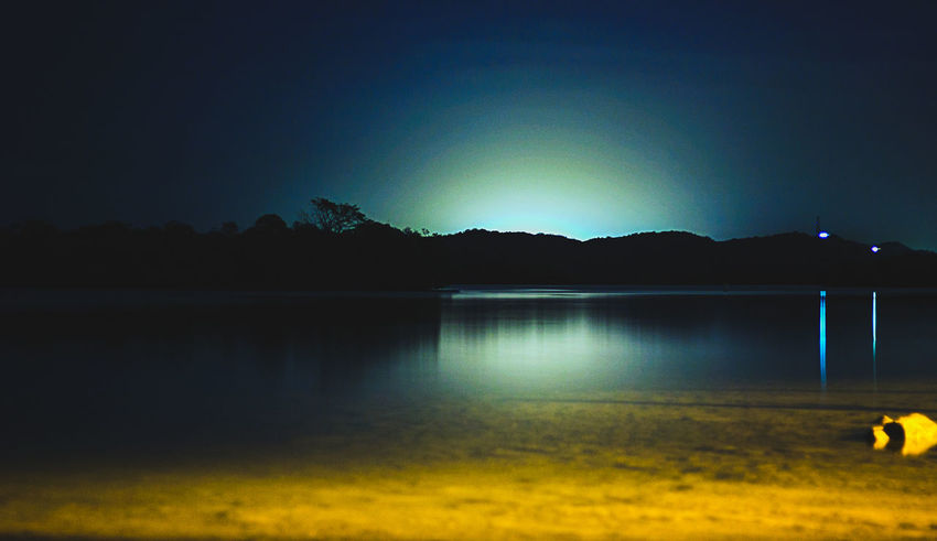 ''Cloudy-Nights'' Night Lake Moon Outdoors Nature Landscape Beauty In Nature Sky No People Scenics Illuminated Water Mountain Tree Astronomy Star - Space Bird Yellow Color Blockıng The Great Outdoors - 2017 EyeEm Awards Week On Eyeem Live For The Story EyeEmNewHere Beauty In Nature Colors