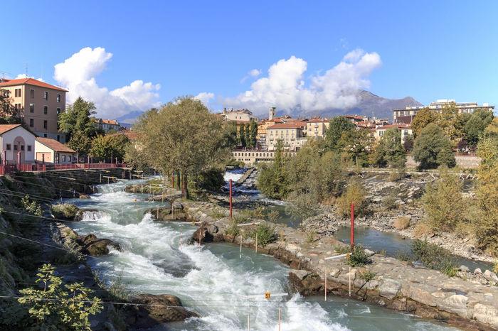 Dora Baltea River and Ivrea cityscape in Piedmont, Italy Canavese Canoe Canoeing Dora Italy Ivrea Olivetti