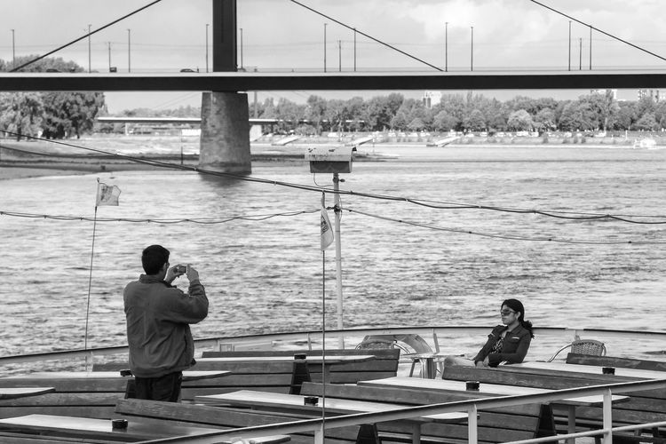 Rheinufer, Duesseldorf, Germany Black & White Black And White Blackandwhite Bridge - Man Made Structure Deutschland Duesseldorf Germany NRW Rhein Rheinufer Rheinufer Düsseldorf Rhine Taking Photos Taking Photos Of People Taking Photos The Tourist Tourist