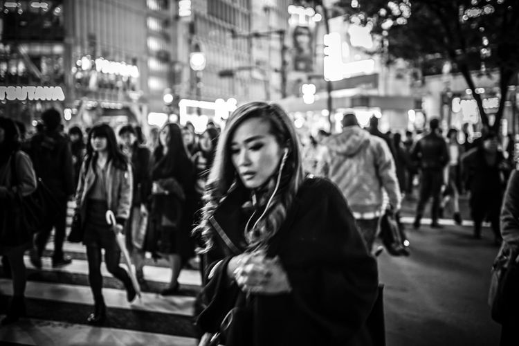 """""""Unclear Crossing"""" Woman EyeEmNewHere EyeEm Best Shots Streetphotography Love Yourself Architecture Building Exterior Built Structure City Crowd Focus On Foreground Large Group Of People Leisure Activity Lifestyles Night Outdoors People Real People Street Women Young Adult The Modern Professional The Art Of Street Photography My Best Photo"""