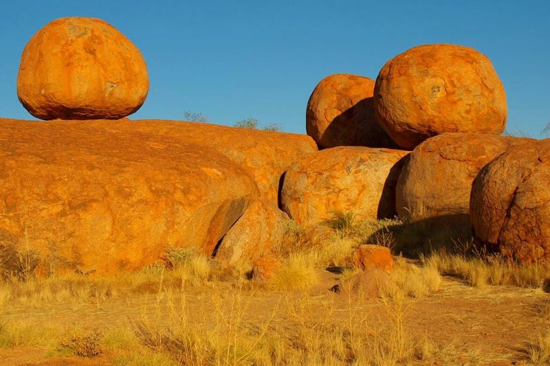 Wind and erosion formed this natural Balancing Act . Taken in the Australian Outback . It's called the Devils Marbles . EyeEm Gallery Beautiful Nature EyeEm Best Shots - Sunsets + Sunrise Orange By Motorola