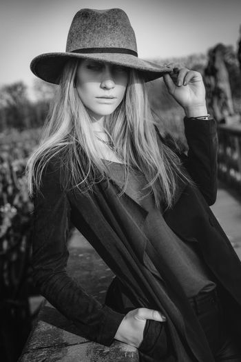 Fashionista Blackandwhite Blonde Blonde Girl Casual Clothing Confidence  Contemplation Day EyeEm Best Shots Fashion Focus On Foreground Hat Jacket Lifestyles Long Hair Longhair Monochrome Negro Black Blanco White Noir Et Blanc Outdoor Outdoors Portrait Portrait Of A Woman Shadow Style Vogue