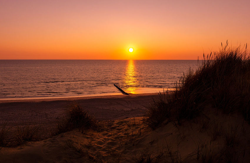 Sunset Kampen, Sylt North Sea Coast Sylt, Germany Beach Beach Sunset Beauty In Nature Horizon Horizon Over Water Marram Grass Nature No People North Sea Orange Color Outdoors Sand Scenics - Nature Sea Sky Sun Sunset Sylt Tranquility Travel Destinations Water