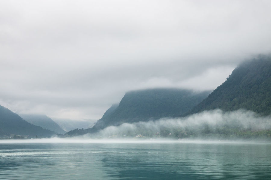 Beauty In Nature Calm Cloud Cloud - Sky Cloudy Dramatic Sky Fjord Fog Green Idyllic Landscape Low Clouds Majestic Mountain Mountain Range Nature Outdoors Overcast Remote Scenics Sky Sognefjorden Water Waterfront Weather