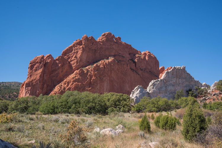 Sep 2018 - Garden Of The Gods Park Arid Climate Beauty In Nature Clear Sky Day Environment Eroded Formation Geology Landscape Mountain Nature No People Non-urban Scene Outdoors Physical Geography Plant Rock Rock - Object Rock Formation Scenics - Nature Sky Solid Tranquil Scene Tranquility
