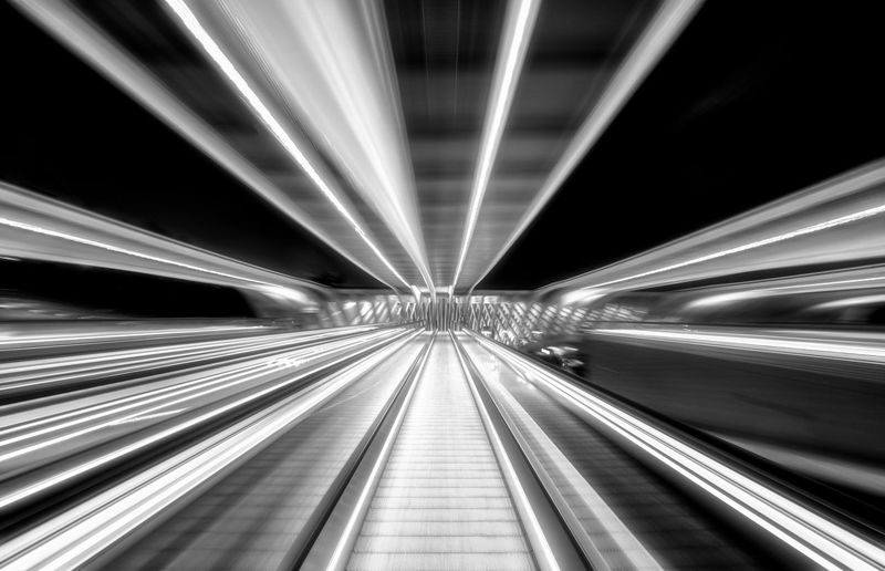 Long exposure motion capture on escalator at night Illuminated Motion The Way Forward Direction Transportation Blurred Motion Long Exposure Speed Architecture vanishing point Diminishing Perspective No People on the move Futuristic Built Structure Night Connection Moving Walkway  Abstract Light Tunnel Modern Futuristic LINE Perspective Bnw