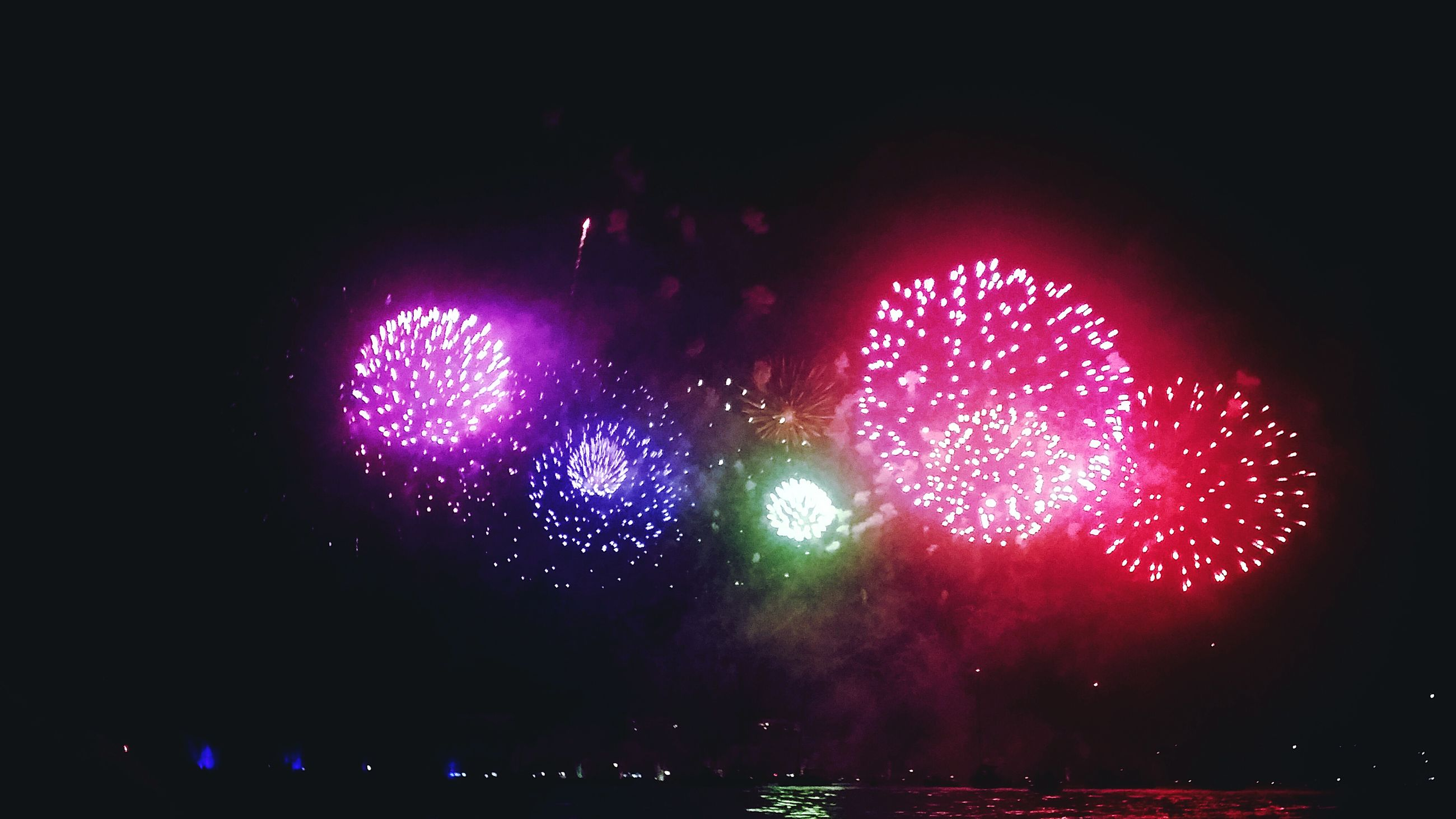 night, celebration, illuminated, arts culture and entertainment, glowing, firework display, no people, firework - man made object, event, outdoors, low angle view, multi colored, firework, sky, close-up