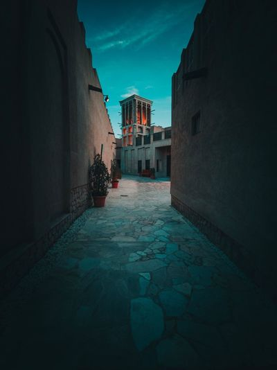 Huawei Photography HUAWEI Photo Award: After Dark Old Town Dubai Architecture Built Structure Building Exterior Building Residential District Nature No People Sky City Day Direction Shadow Outdoors Wall - Building Feature Wall Street