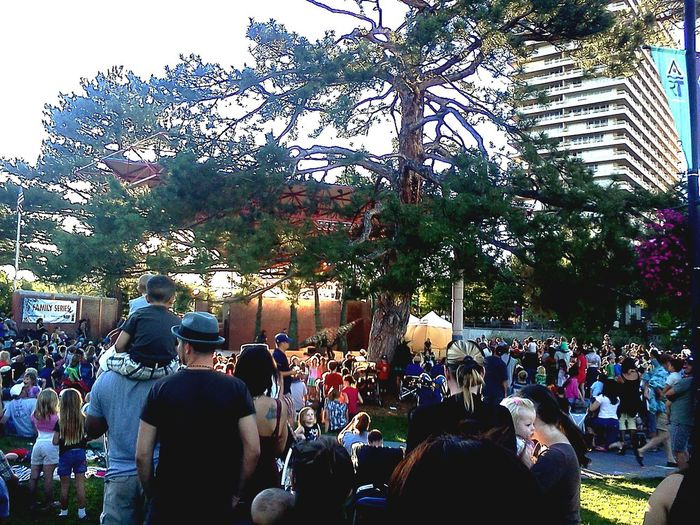 Large Group Of People Celebration Tree Crowd Outdoors People Day Puppet Show Larger Than Life Dinosaurs Full Sized Puppets Life Size Puppets Group Learning Public Participation The City Light