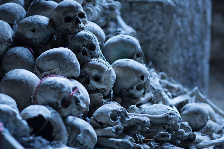 Rosary beads on human skulls and bones in cave