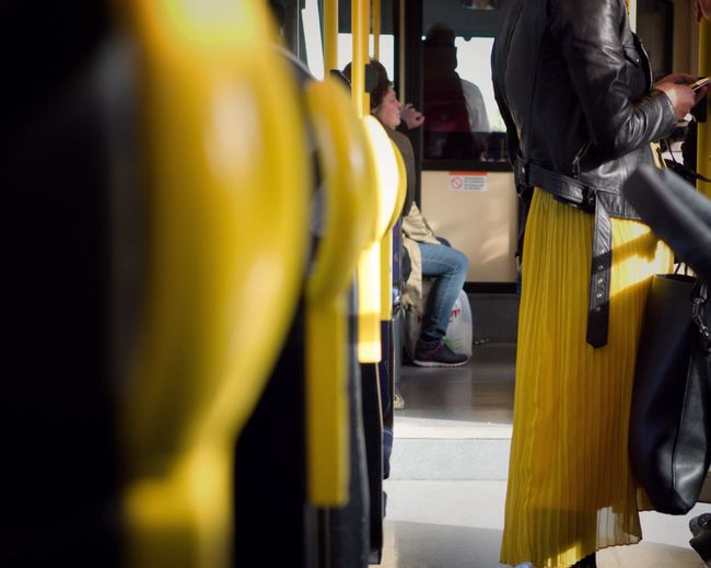 It was all yellow Colours Public Transportation Transportation Mode Of Transportation Rail Transportation Human Body Part Train People Travel Yellow City