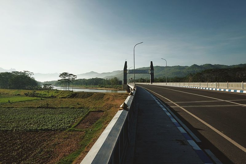 Sirnoboyo Bridge Sky Street Light Nature Plant Street Day Clear Sky Diminishing Perspective Lighting Equipment Sunlight Railing No People Outdoors Water Road Transportation Footpath The Way Forward Direction Tree