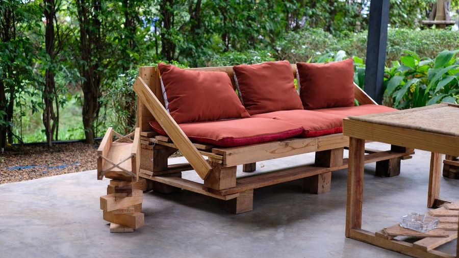 Design from pallet wood for the comfortable Armchair Chair Coffee Table Comfortable Cozy Cushion Flooring Furniture Pillow Red Relaxation Seat Sofa Tree Wood - Material