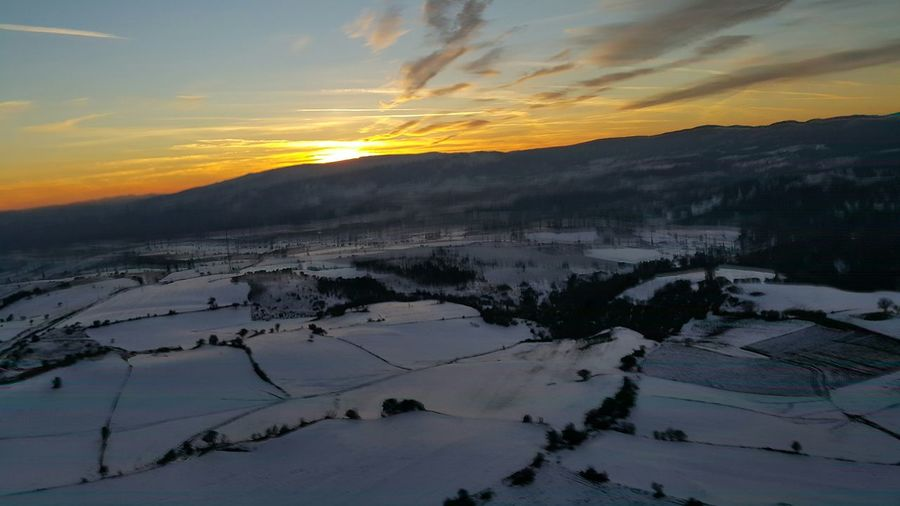 Snow Covered Field At Sunset
