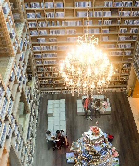 Conversation Real People Conversation Talking Library Hotel Lobby Taiwan Gaia Hotel Book Shelves Lifestyles Leisure Activity Illuminated Architecture