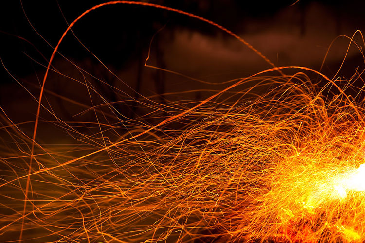 Abstract Blurred Motion Bonfire Burning Campfire Celebration Complexity Fire Fire - Natural Phenomenon Glowing Heat - Temperature Illuminated Light Light Painting Light Trail Long Exposure Motion Nature Night No People Orange Color Sparks Speed Wire Wool