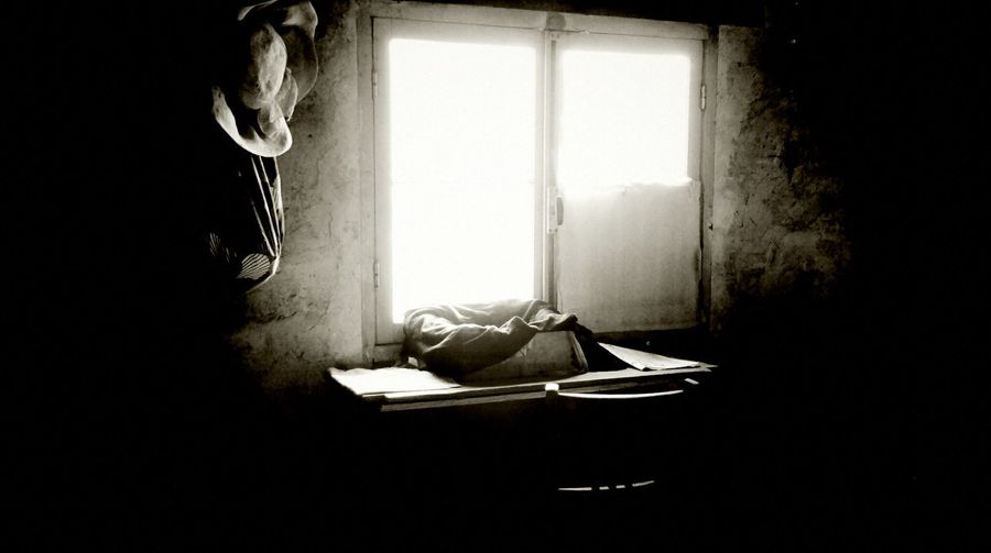 Man on bed against window
