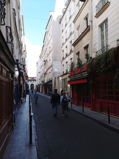Latin District Latin Community Latin Community In Paris City Street Street Architecture Building Exterior Adult People France Paris Paris, France  CityFrance🇫🇷 Outdoors Built Structure Day Large Group Of People Sky Adults Only Small Street Couple Couples Shoot Couple Is Speaking
