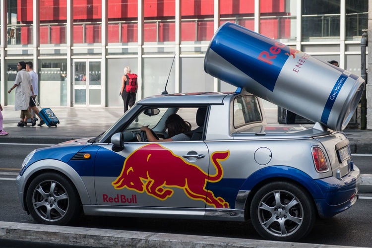 Berlin, Germany - September 7, 2017: Red Bull advertisement car. Created in 1987, Red Bull is an energy drink sold by Austrian company Red Bull GmbH, with the highest market share of any energy drink in the world Advertising Beverage Logo Advertisement Caffeine Addict Car Design Drink Editorial  Label Marketing Mode Of Transport Outdoors Symbol Taurus Transportation