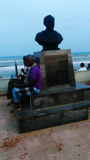 Local People Sitting Under Late PM Rajiv Gandhis Statue