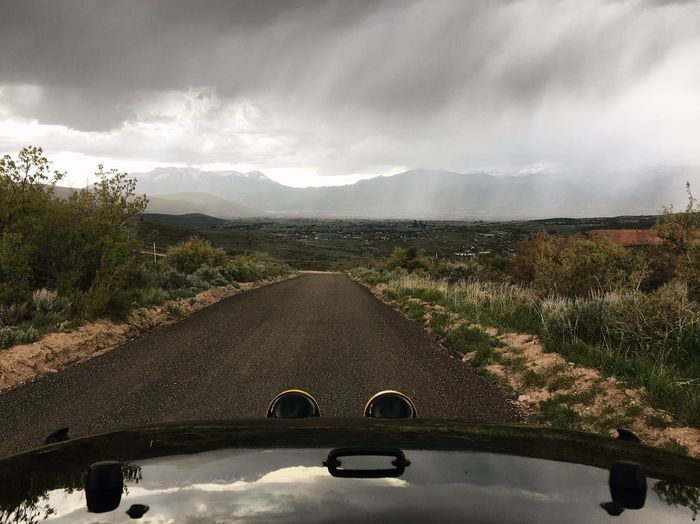 rain line cutting right through Heber valley late this afternoon. this morning it was a fog line. Storms Wasatch Mountains Utah Cloud - Sky Sky Nature Car Day Motor Vehicle Plant