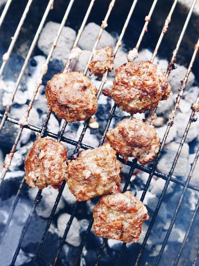 High angle view of meatballs being grilled on barbeque