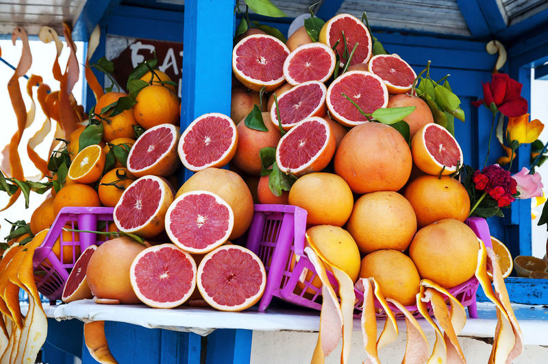 Low angle view of grapefruits for sale at market stall