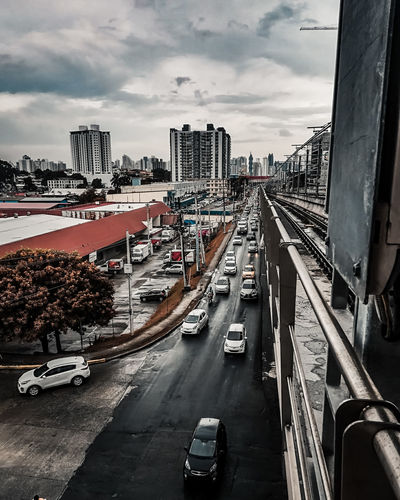 High angle view of traffic on road amidst buildings