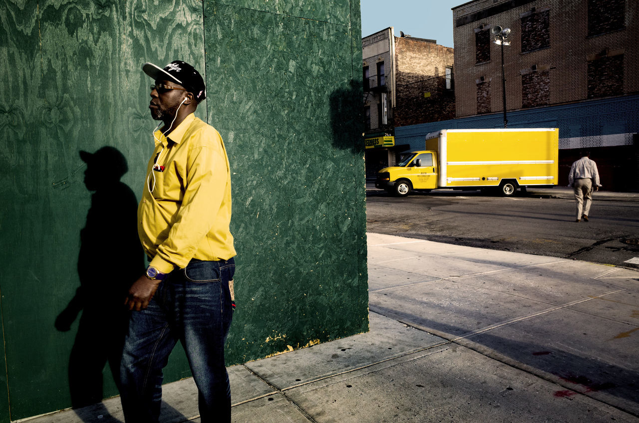 yellow, real people, standing, city, men, outdoors, two people, day, full length, building exterior, young adult, adult, people