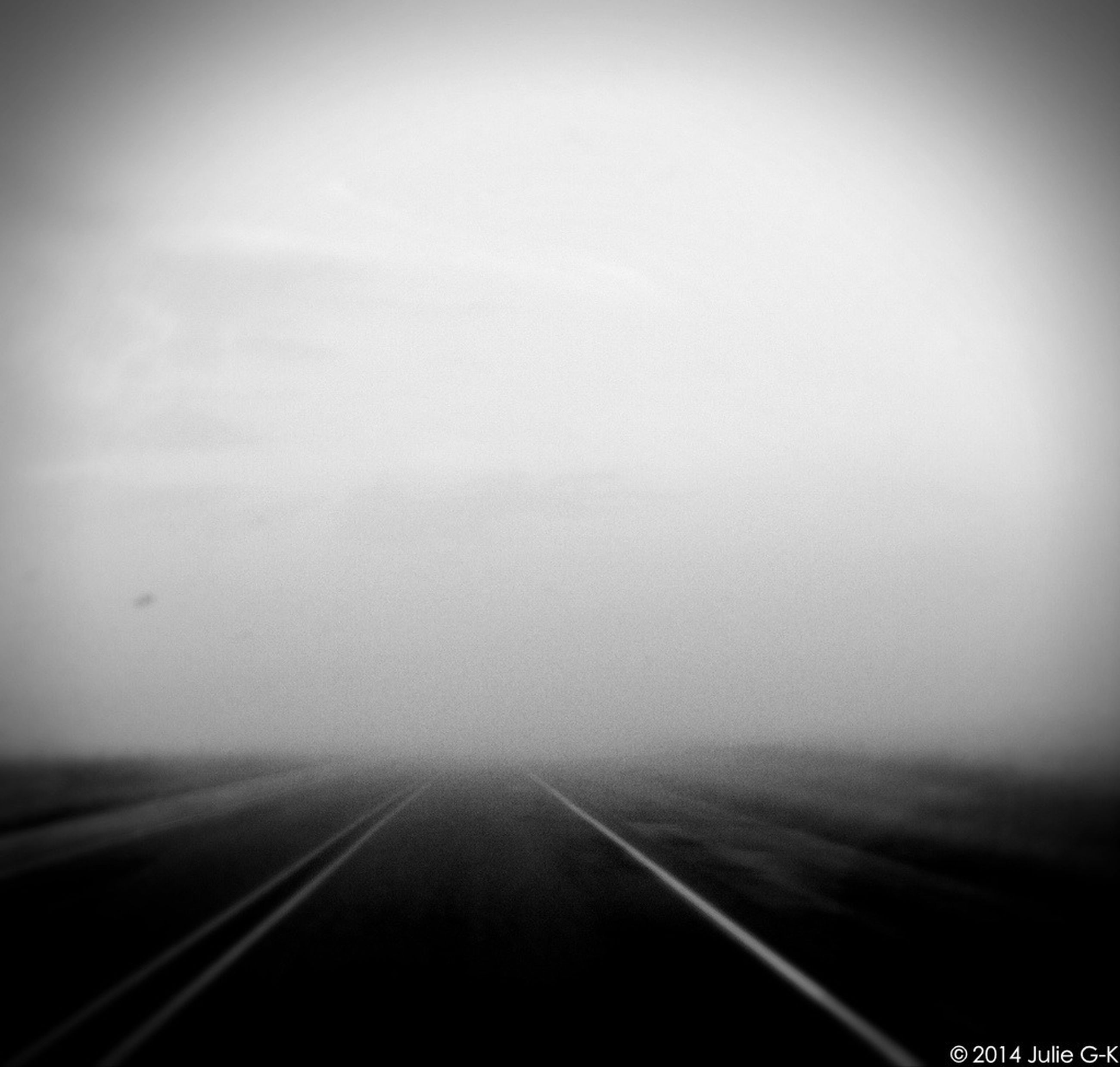transportation, the way forward, diminishing perspective, road, fog, vanishing point, road marking, copy space, foggy, sky, no people, nature, tranquility, weather, day, outdoors, landscape, empty, long