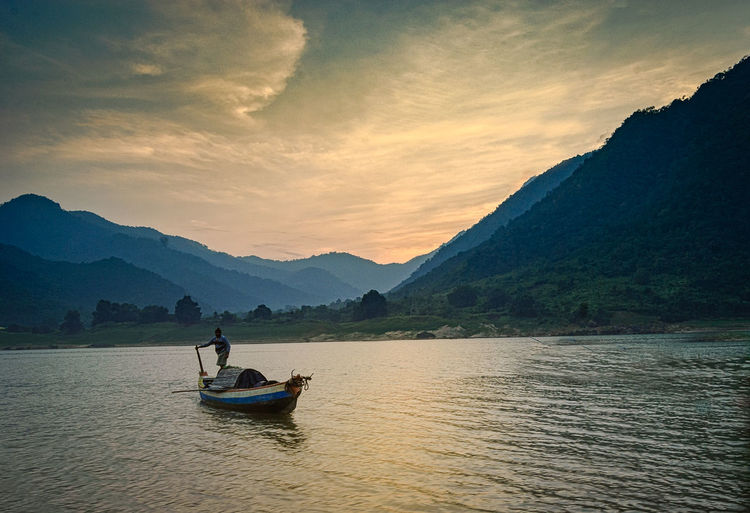 Golden Sunset Beauty In Nature Cloud - Sky Gondola - Traditional Boat Gunbir Kayak Lake Landscape Mountain Mountain Range Nature Nautical Vessel Nikon One Man Only One Person Only Men Outdoors Pedal Boat People Reflection Scenics Sky Sunset Travel Destinations Vacations Water