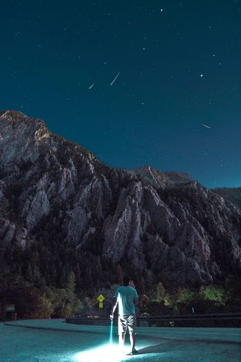 Night sky Mountain Night Star - Space One Person Rear View Astronomy Nature Beauty In Nature Real People Sky Stars Stargazing Night Flashlight