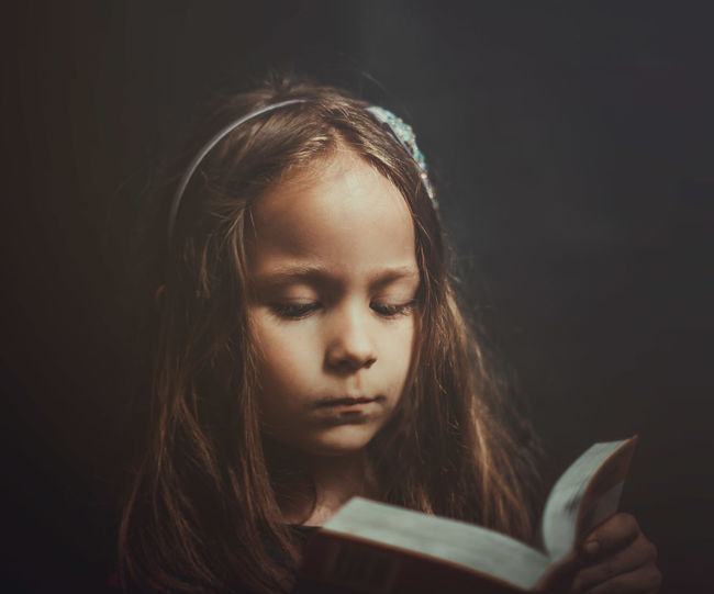 Portrait Of Girl Reading Book