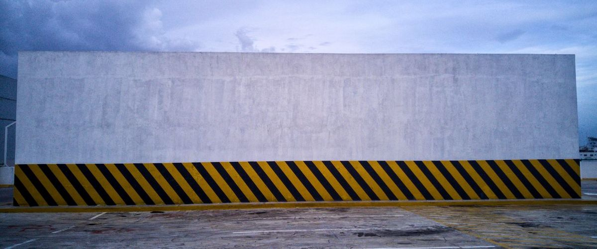 Wall Caution Built Structure No People Building Exterior Outdoors Architecture Close-up Day City Stripes Pattern Warning Rooftop