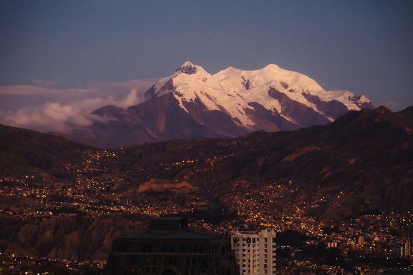 Awesome evening view to Illimani over La Paz, capital of Bolivia. Bolivia Citylights Mountain Mountain Range No People Sky Outdoors Nature Beauty In Nature Architecture Night Cityscape